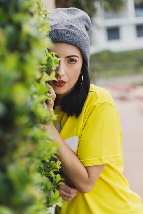 Woman in Yellow Shirt on Focus Photography