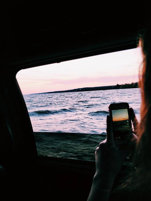 Person Taking Photo Of Ocean
