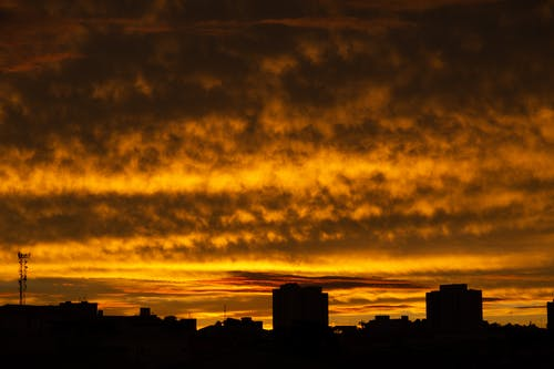 Silhouette of Building Across Yellow Clouds Photo