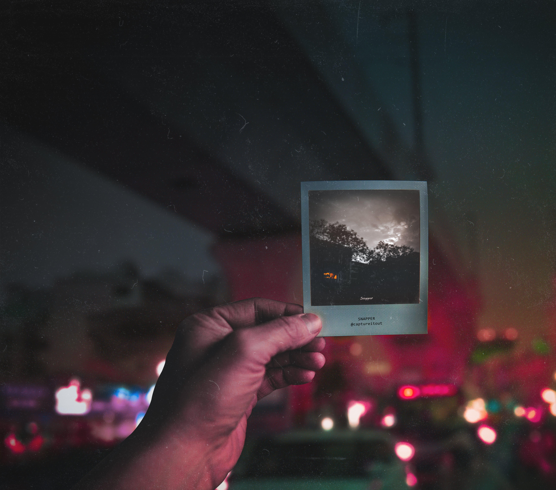 Free stock photo of hand, lights, polaroid, traffic