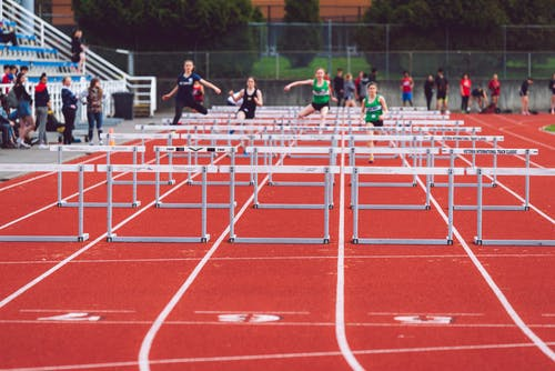Shallow Focus Photo of People Playing Track and Field