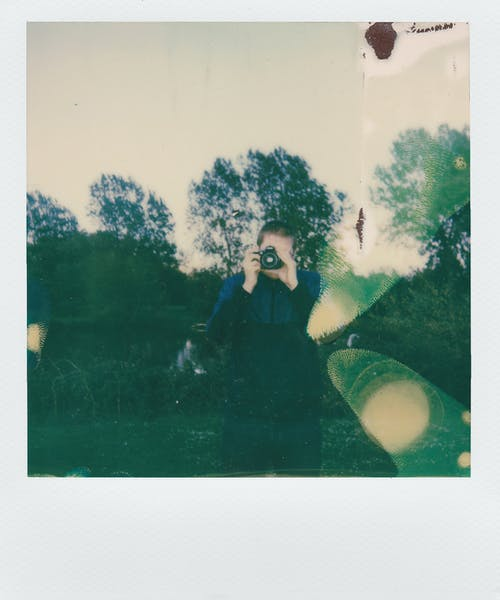 Instant Photo Of Man Taking A Photo