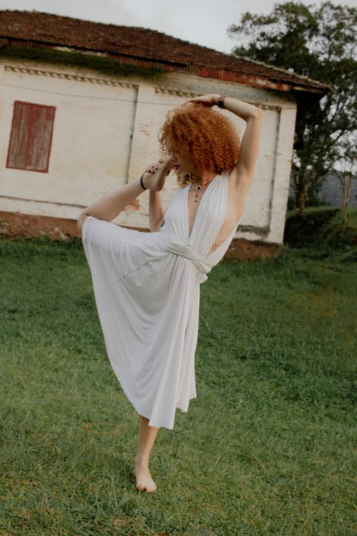 Woman in White Haltered Midi Dress