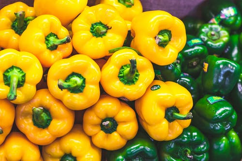Close-up Photo of Green and Yellow Bell Peppers