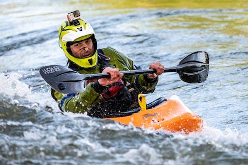 Man Riding Orange Kayak Boat