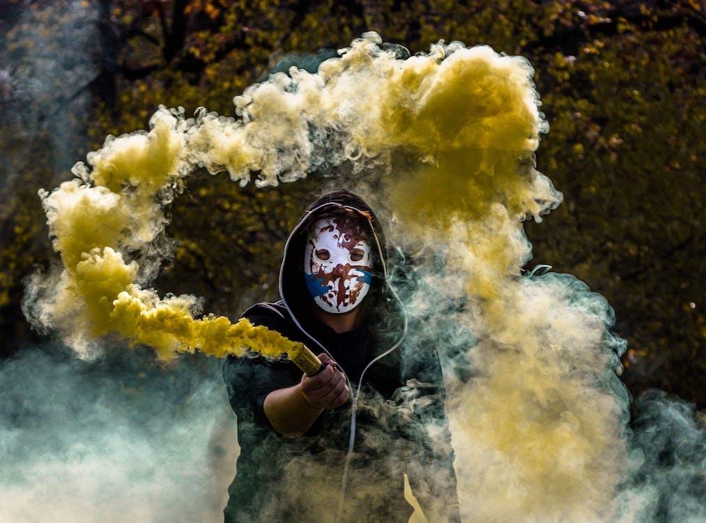 Person Holding Yellow Smoke