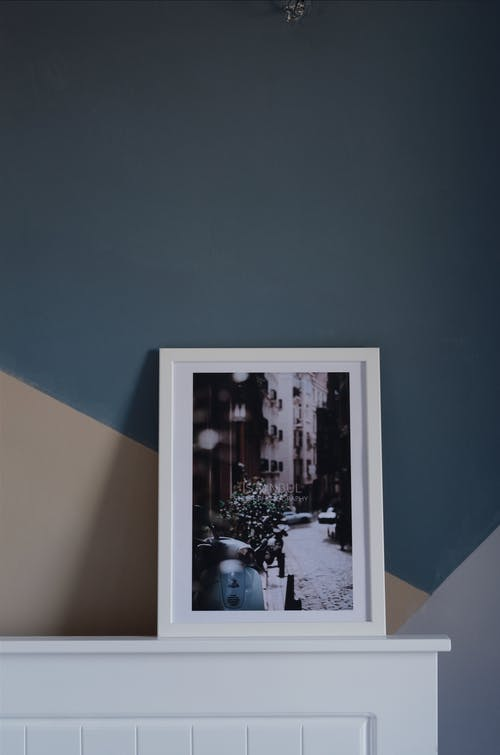 White Photo Frame Beside Wall