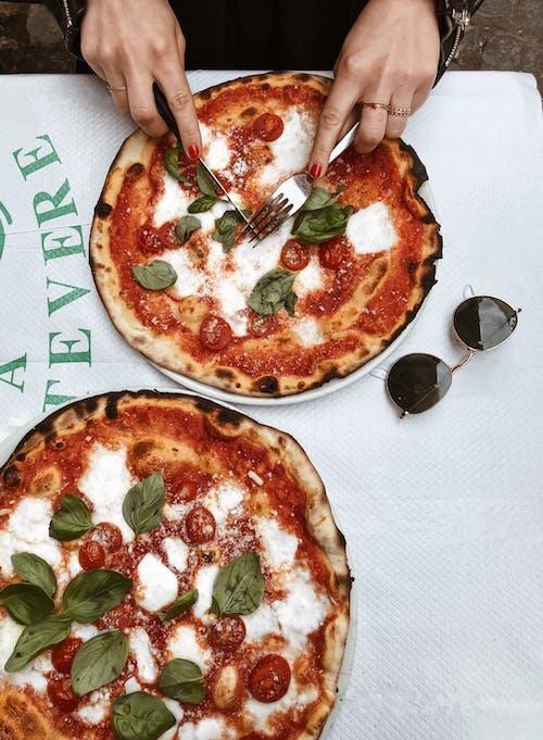 Person Slicing Pizza