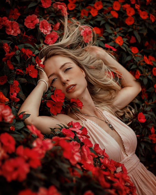 Woman Lying On Red Flowers
