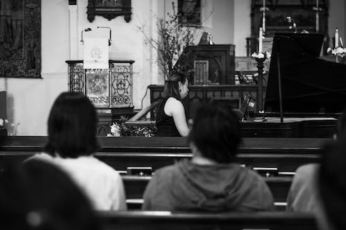 Grayscale Photography of People Sitting on Church Pew