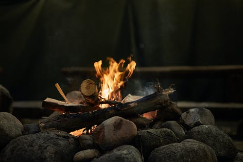 Burning Wood Above Rocks