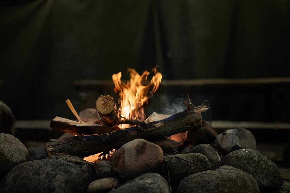 Burning Wood Above Rocks