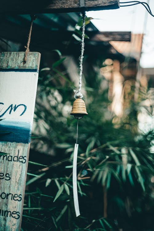 Selective Focus Photography of Hanging Bell