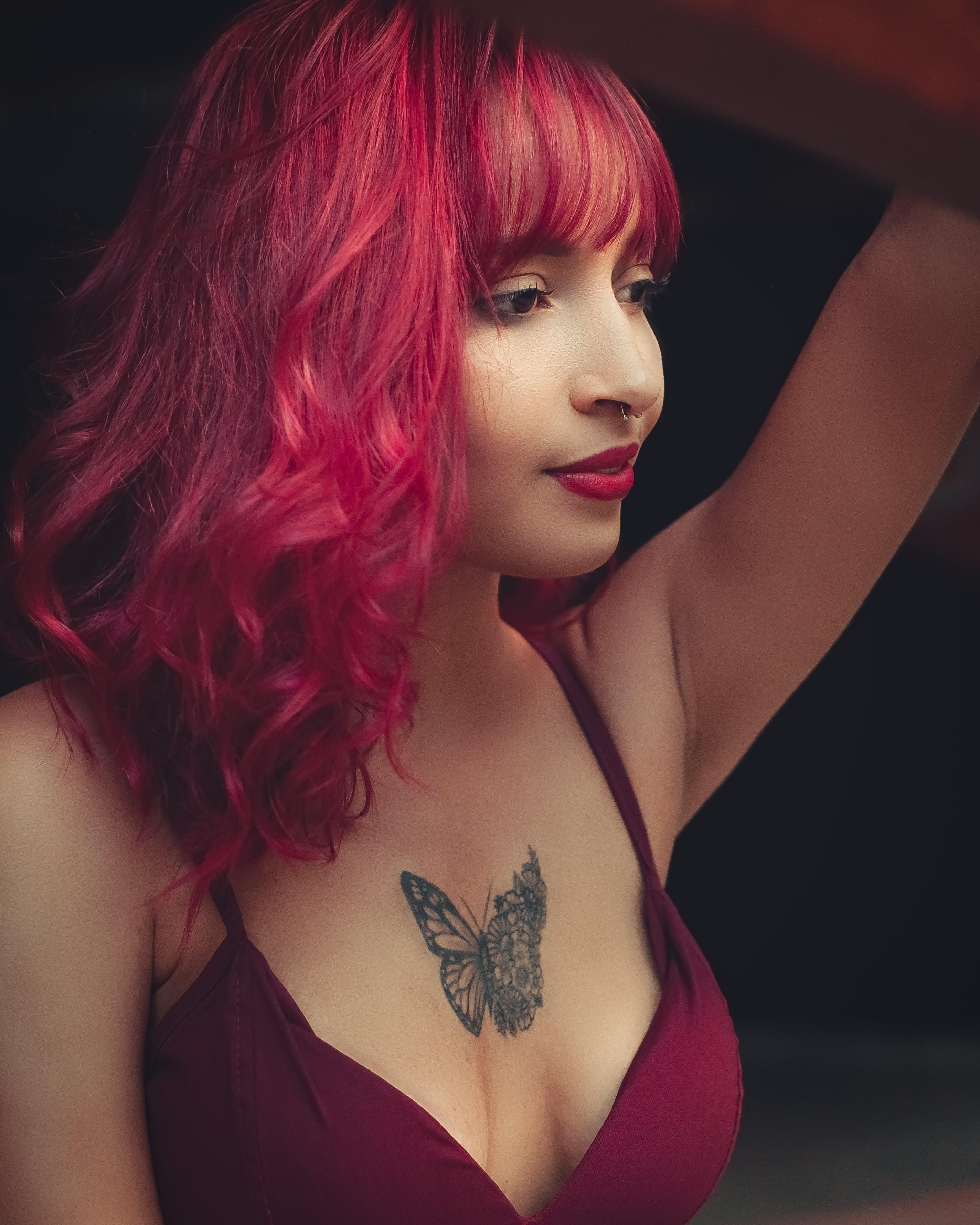 Woman Wearing Bra With Butterfly Tattoo On Chest
