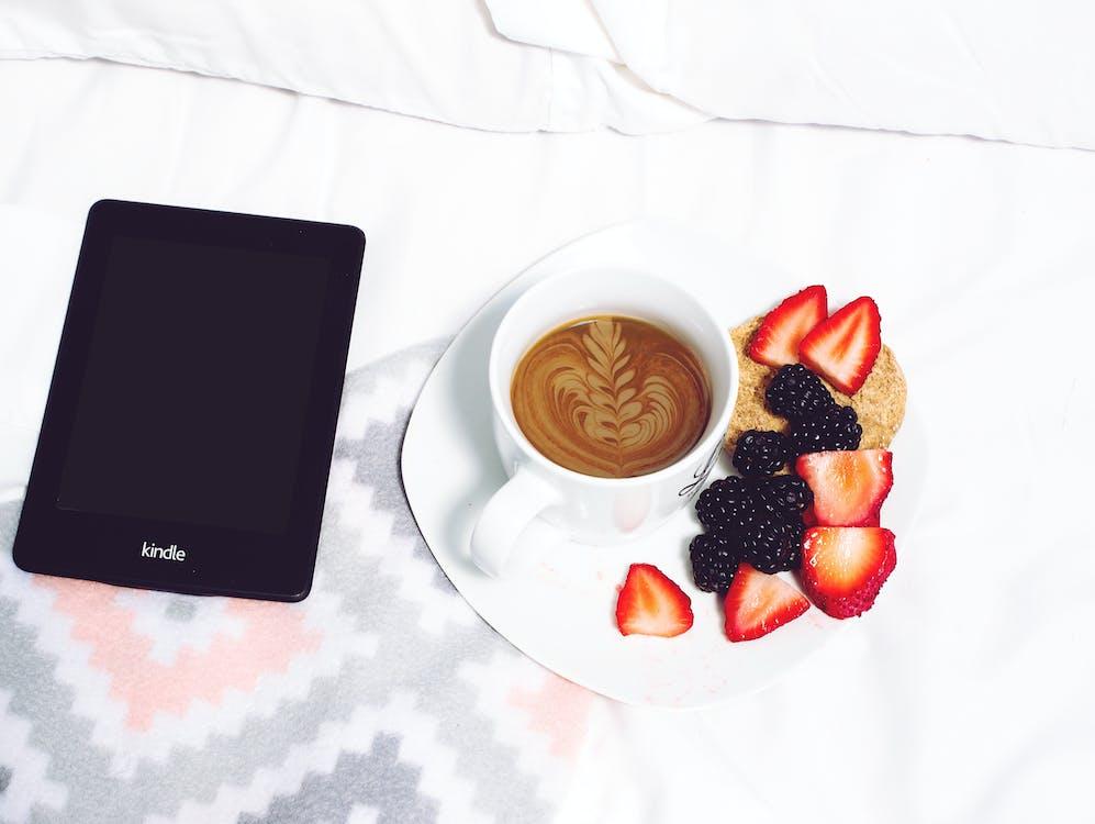 Latte in Cup Beside Strawberries And Raspberries