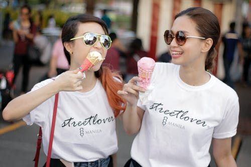 Women In White T-shirts Holding Ice Cream In Cones
