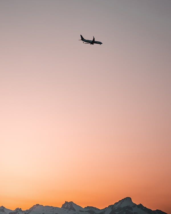 Airplane in Sky during Golden Hour