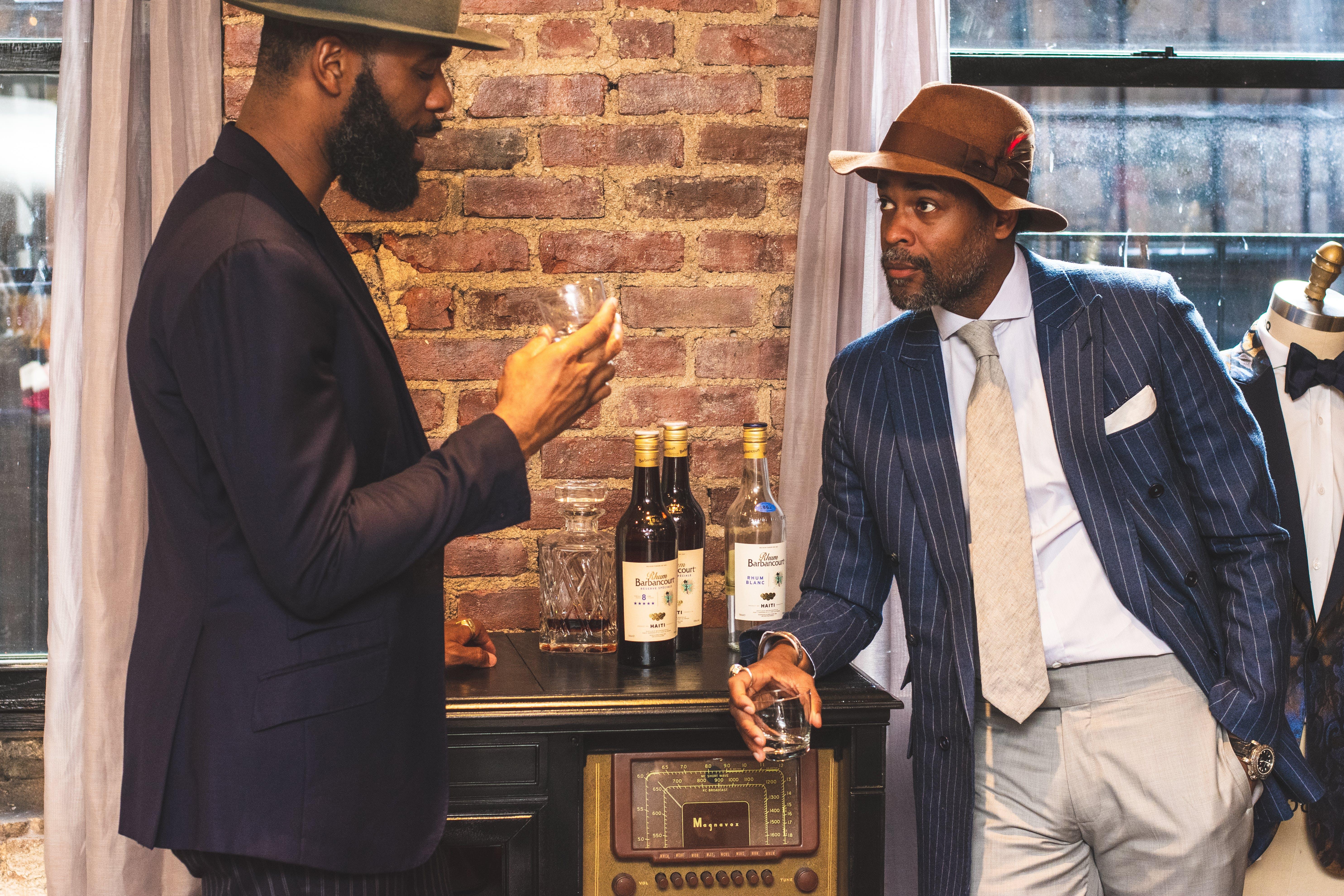 Two Men Holding Shot Glasses