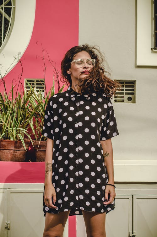 Woman Wearing Black And White Polkadot Short Sleeve Dress
