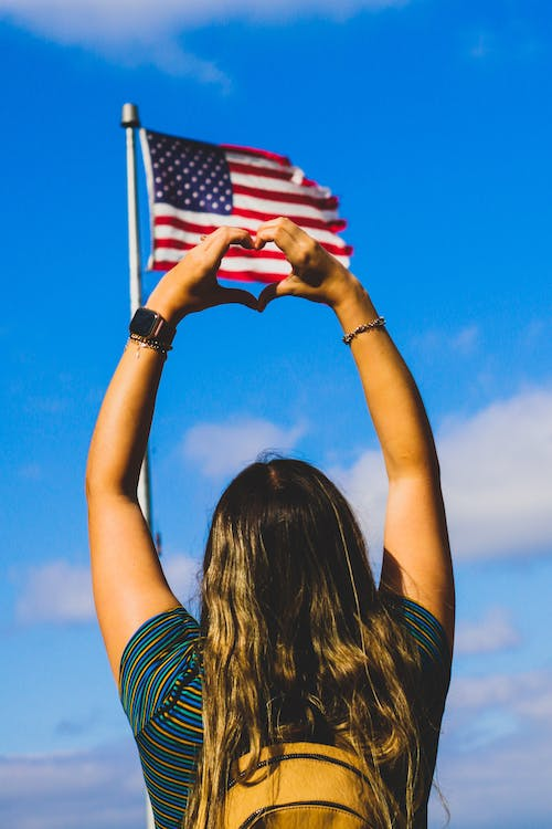 Free stock photo of American flag, clouds, flag, girl