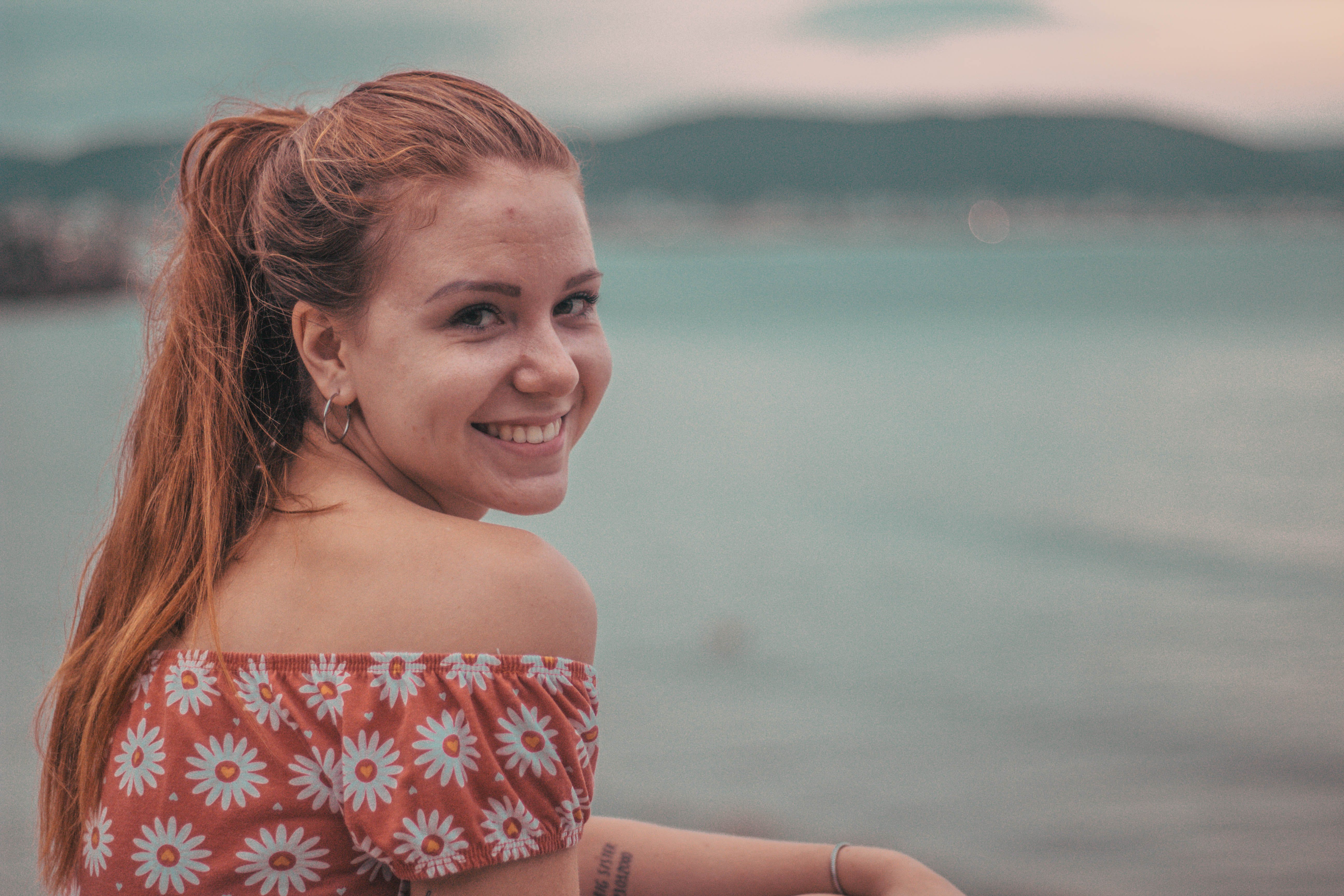 Woman Smiling on Seashore