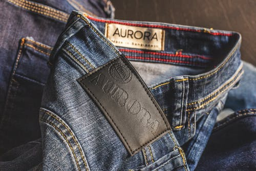 Blue Aurora Denim Bottoms on Brown Wooden Surface