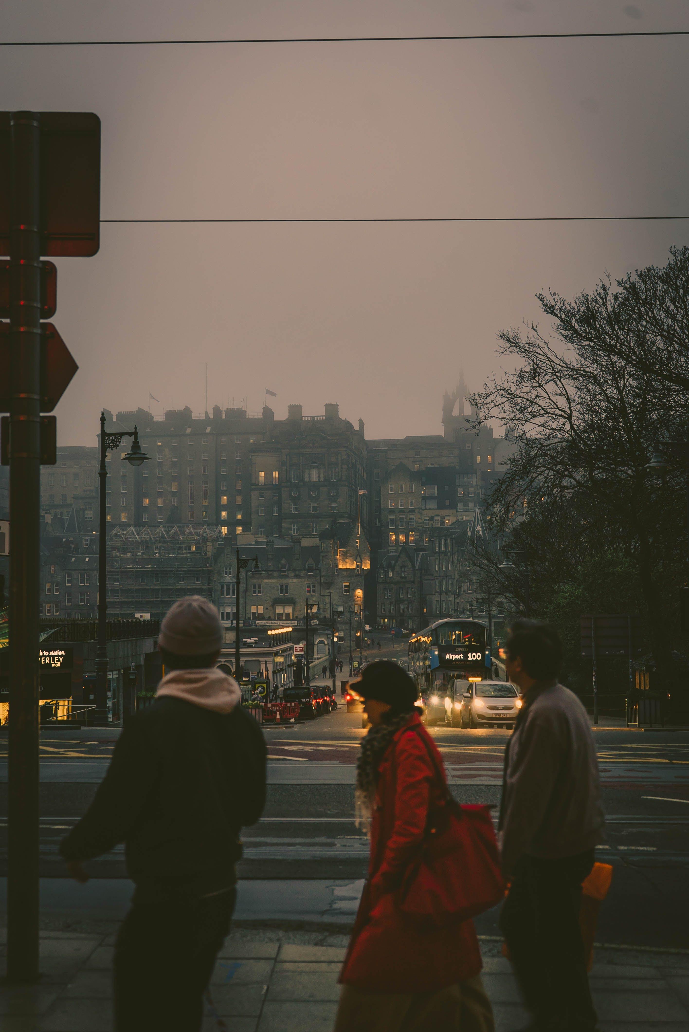 Three Person Crossing Streets