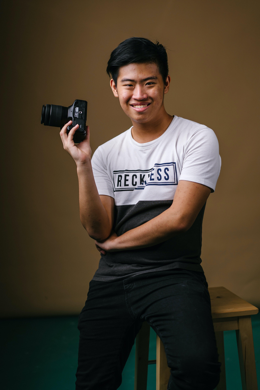 Gratis stockfoto met camera, fotograaf, iemand, kerel