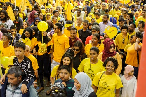 Group of People Wearing Yellow Shirt