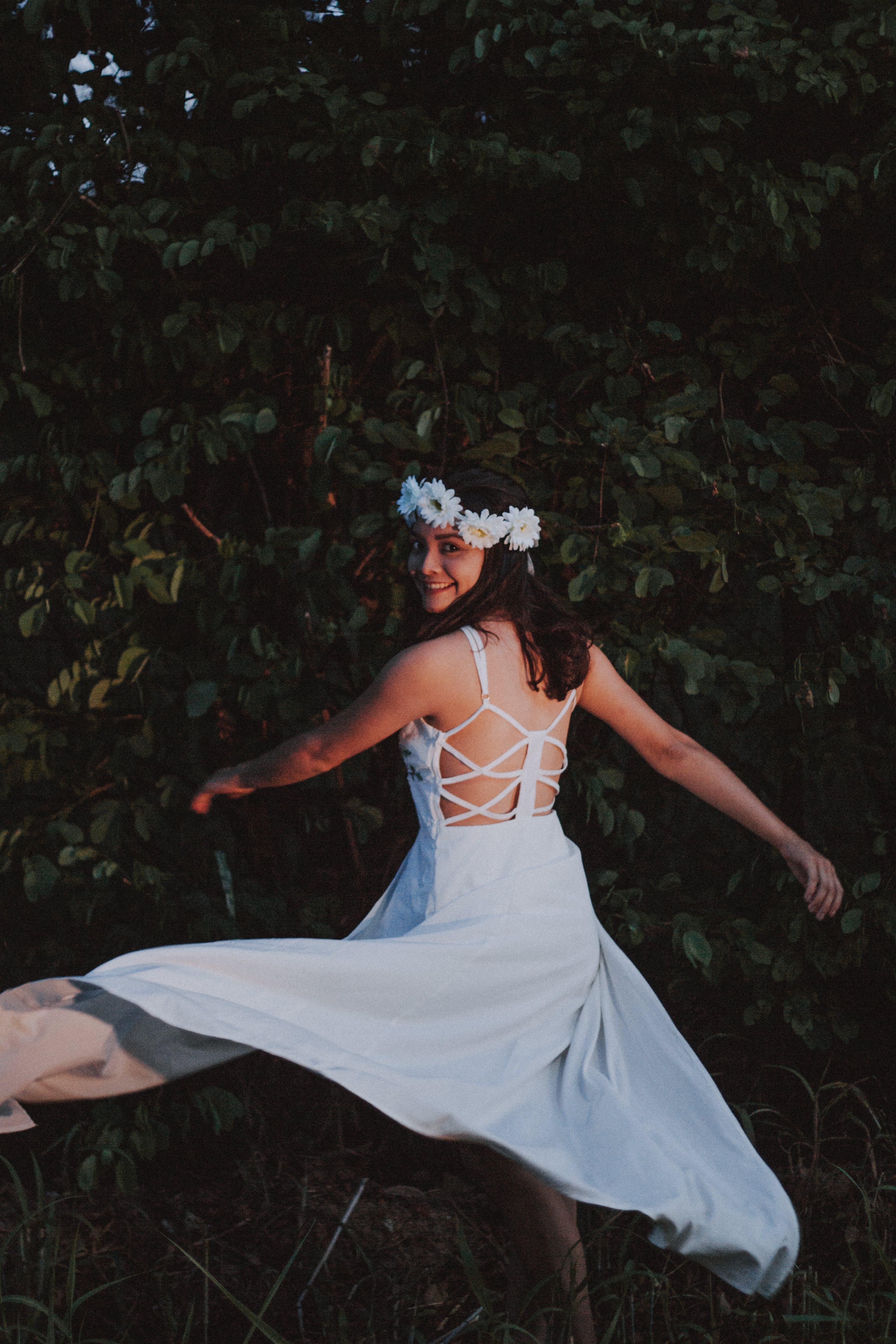 Woman Wearing White Backless Dress Dancing