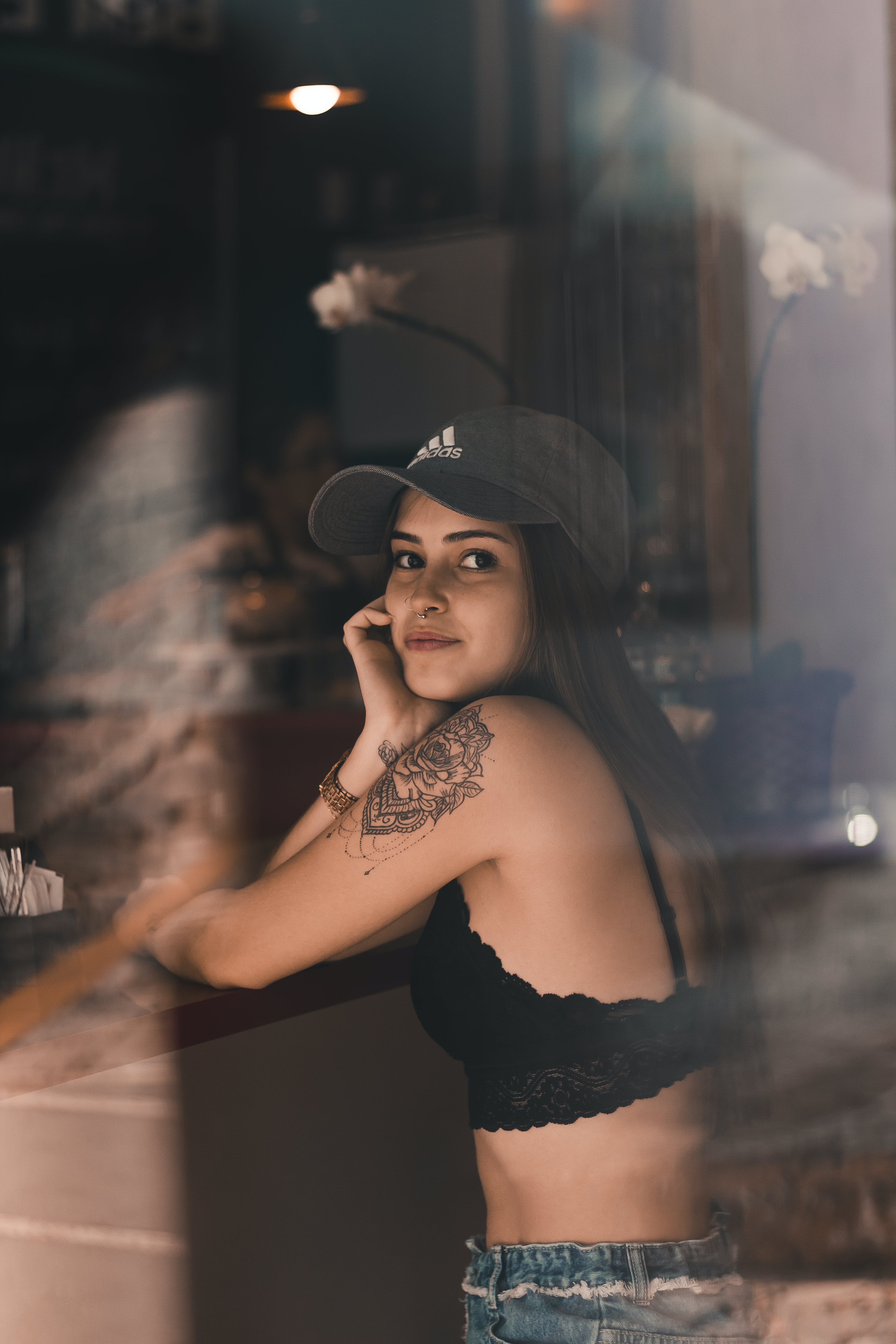 Woman in Black Adidas Cap and Lace Brassiere