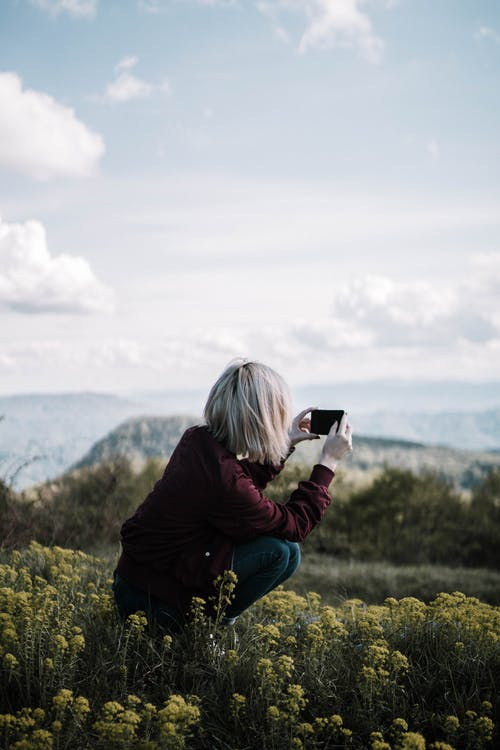Woman Taking Photo Using Smartphone