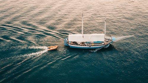 Blue Boat on Ocean