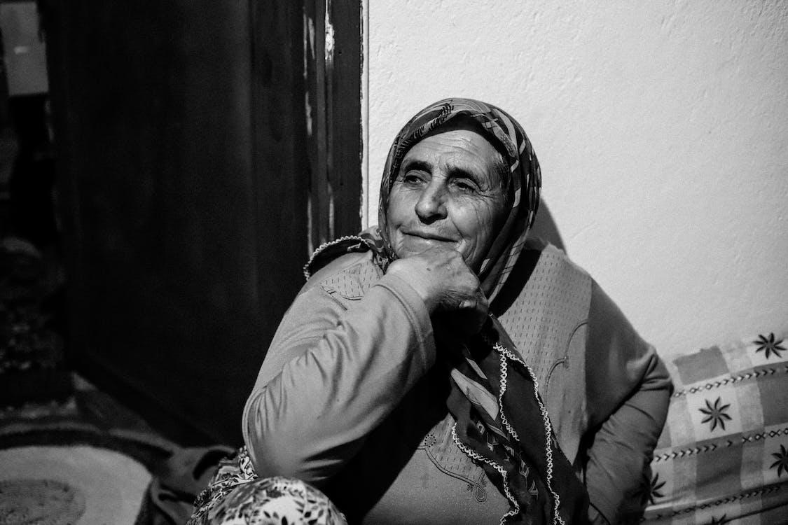 Grayscale Photo of Woman Wearing Headscarf