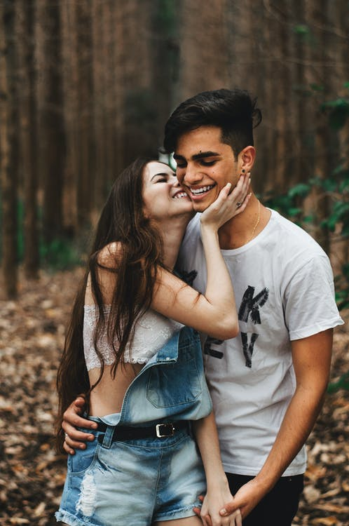 Woman About to Kiss the Man at the Forest