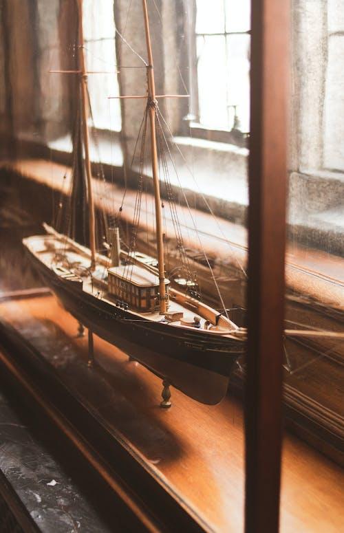 Miniature Ship Beside The Window