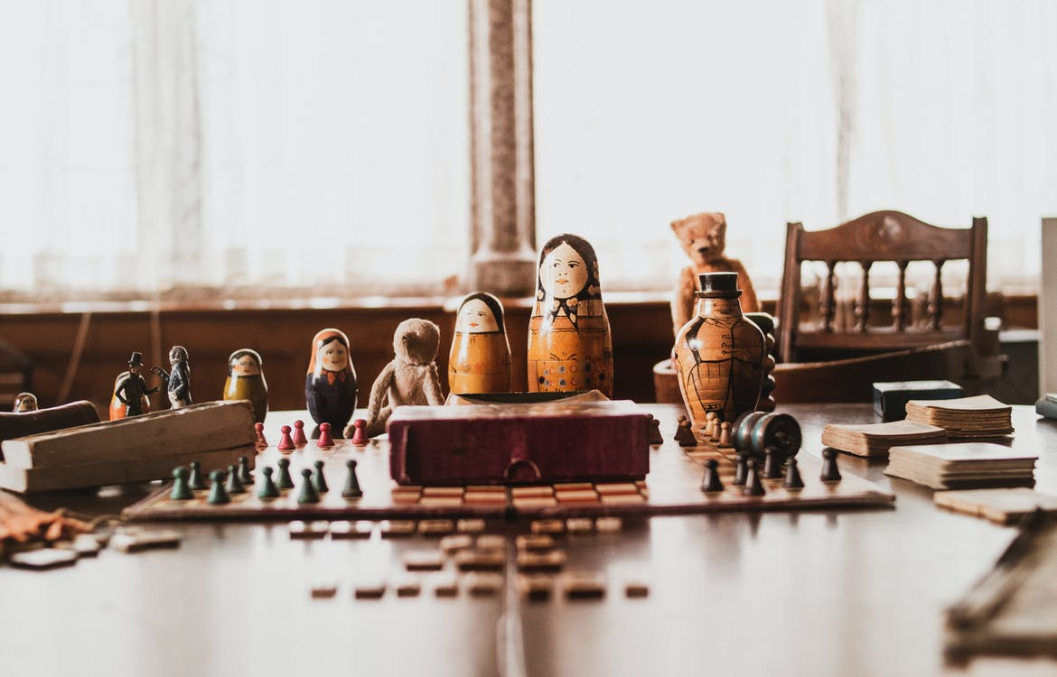 Brown-and-black Nesting Doll on Brown Wooden Table