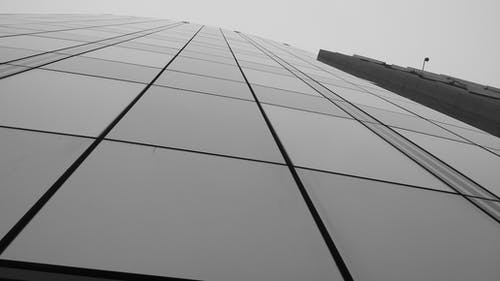 Grayscale Photo of Curtain Wall Building