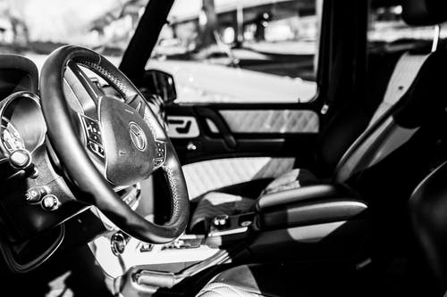 Grayscale Photography of Vehicle Interior
