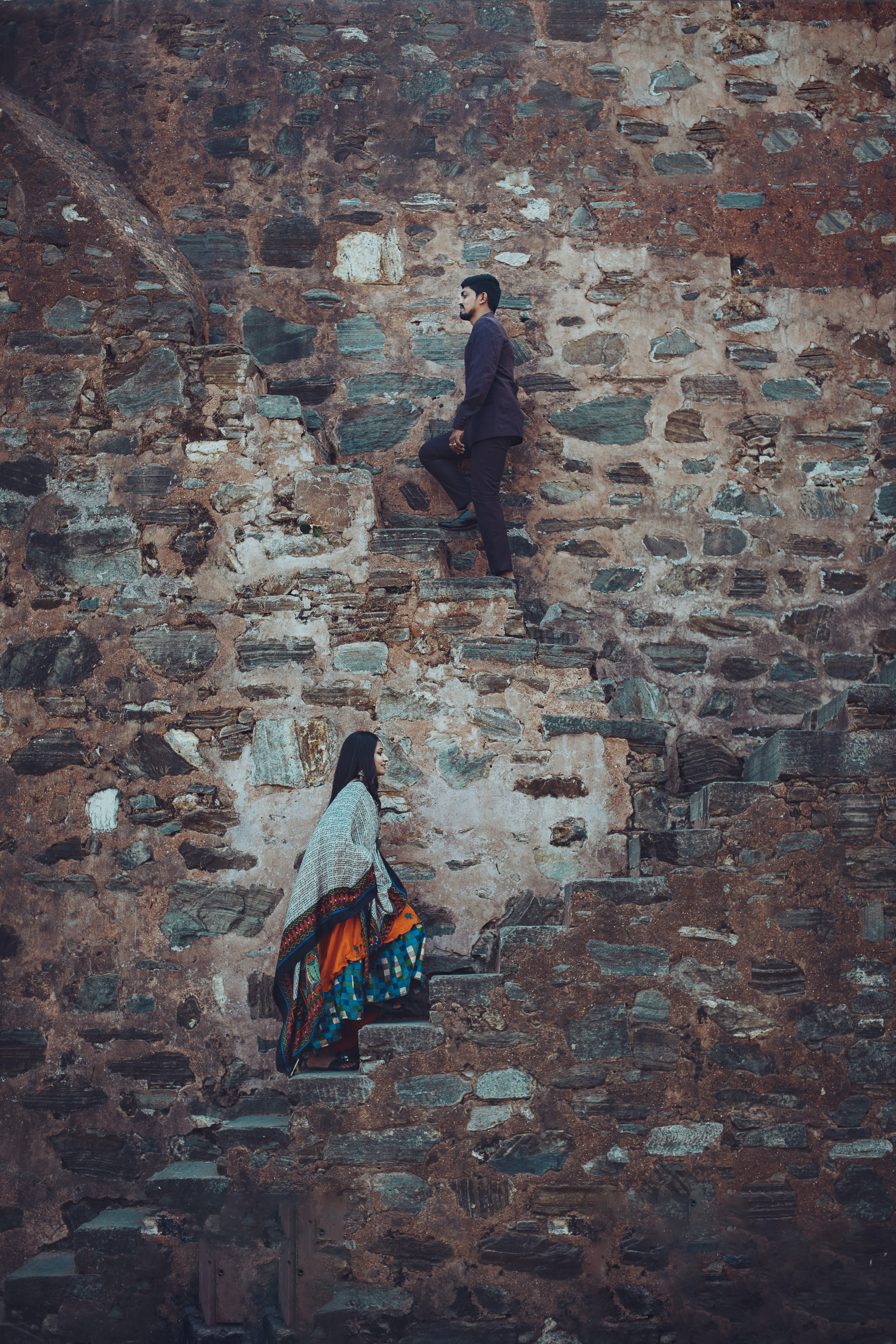 Man and Woman Walking Up the Stairs