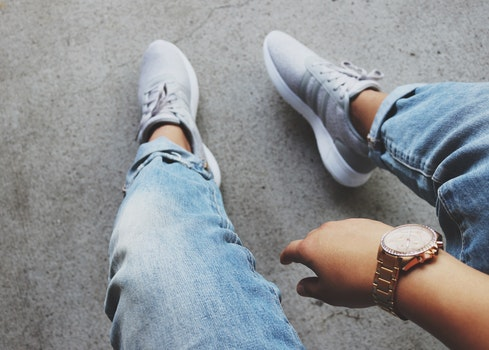 Grey Adidas Sneakers Near Blue Denim Bottoms