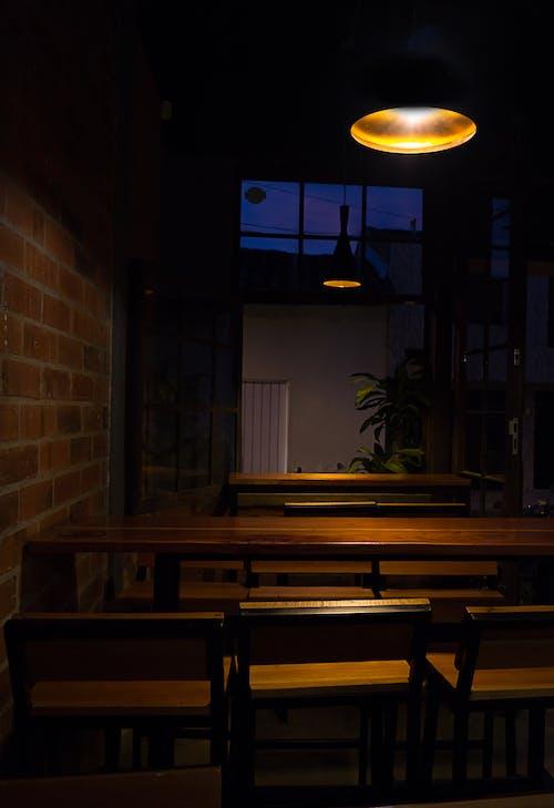Black Pendant Lamp Near Wall