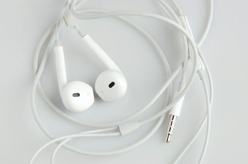 Free stock photo of apple, earphones, high key