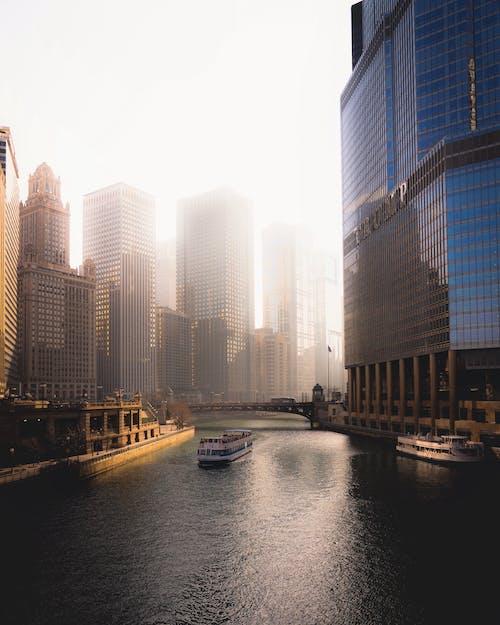 Boat Between High Rise Buildings