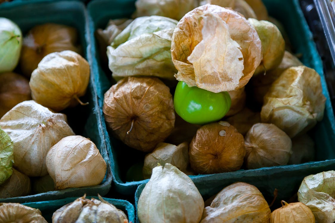 Dried Tomatillos on Blue Containers