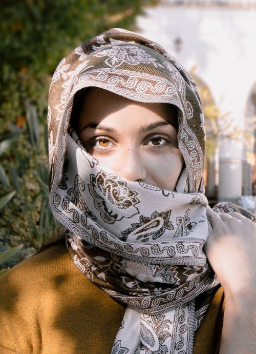 Close-Up Photo of a Woman Wearing Brown and Beige Headscarf