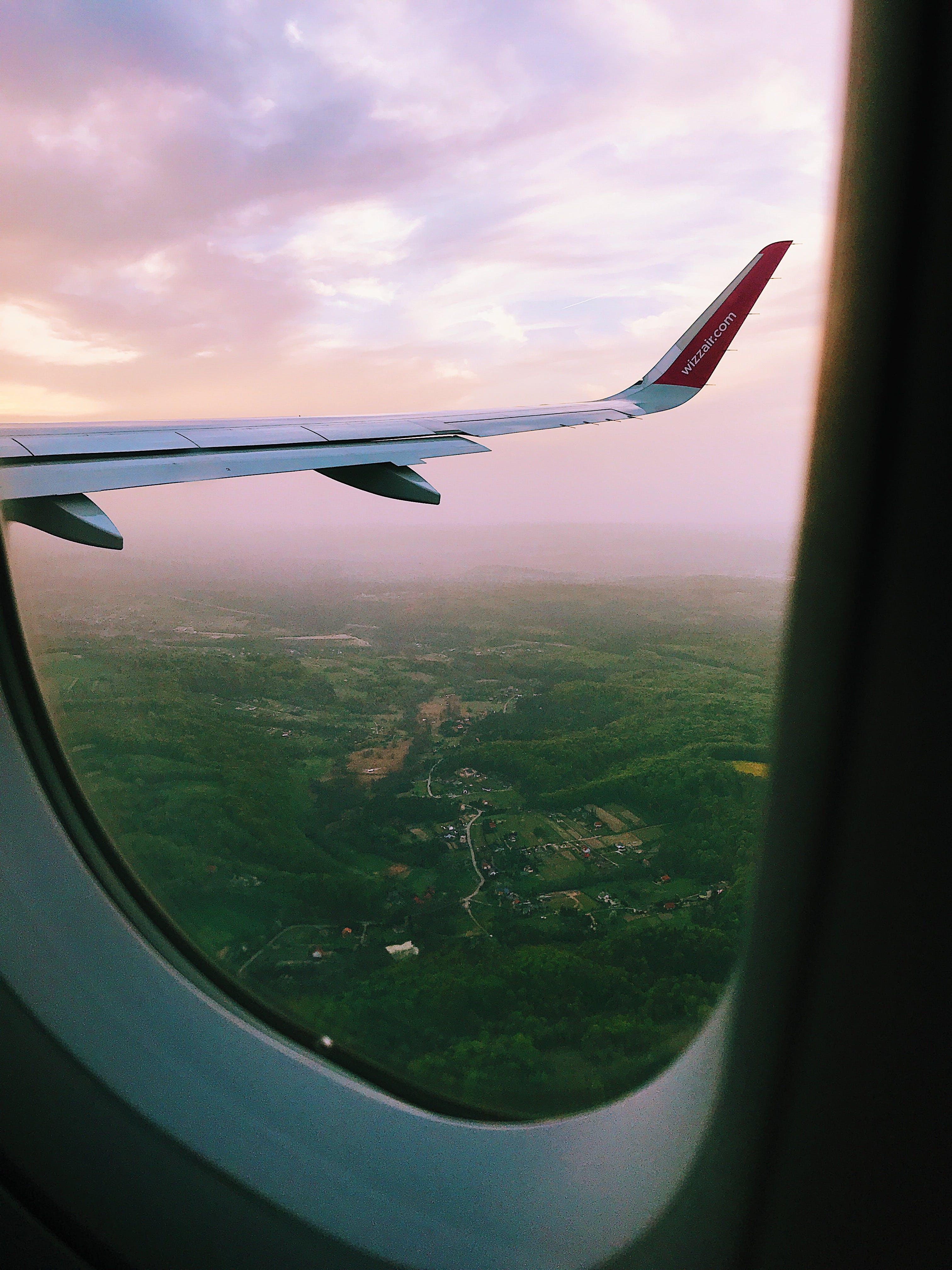Plane Window Across Bent Plane Wing
