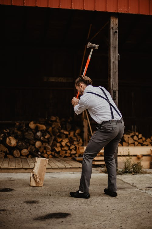 Man Wearing Grey Pants Holding Axe