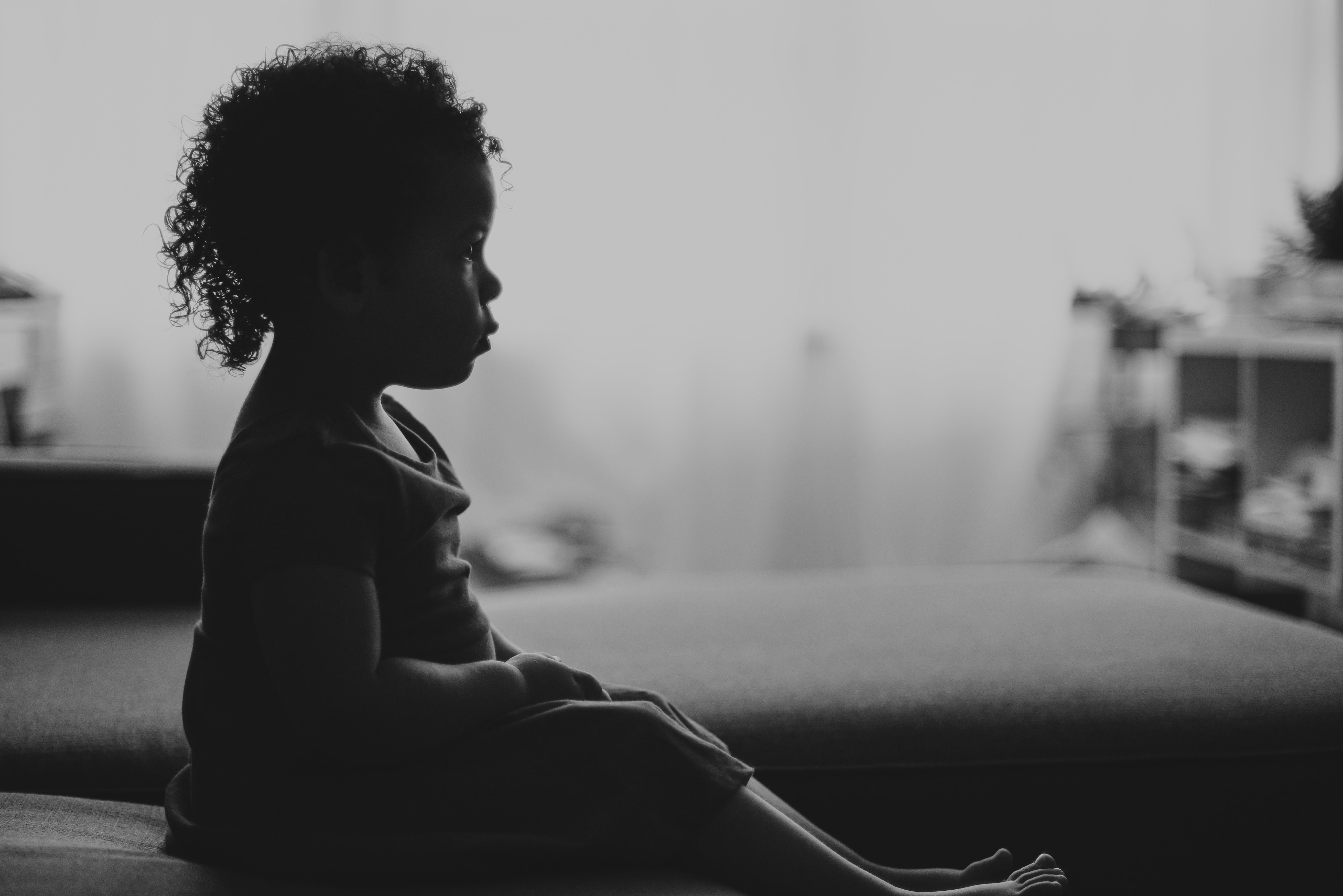 Silhouette Of Girl Sitting