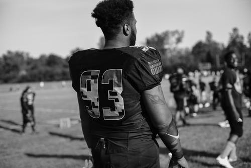 Football Player Grayscale Photo